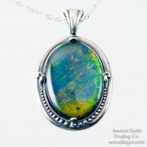 Domed Rainbow Ammolite Gemstone in Silver Setting